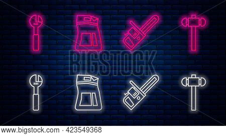 Set Line Cement Bag, Chainsaw, Adjustable Wrench And Sledgehammer. Glowing Neon Icon On Brick Wall.