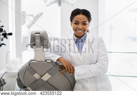 Professional Black Female Stomatologist Doctor Posing At Workplace In Modern Clinic