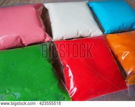 Colorful Kid S Plasticine On White Background, Colorful Dough Modeling Clay. Packing Of Colored Soft
