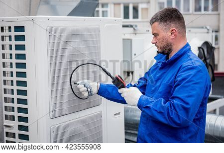 The Technician Uses A Digital Camera To Check The Clogging Of The Heat Exchanger