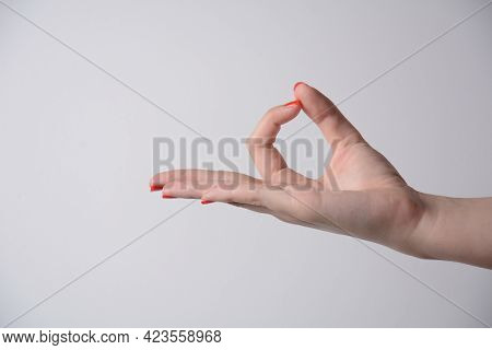 Female Hand Gesture - Ok ,everything Is Good, Right ,zero Empty Place, Worthless, On A Gray Backgrou
