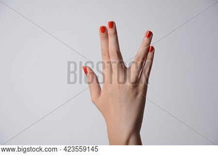 A Girl Hand Doing The Vulcan Salute On A White Background. Vulcan Hand Salute Against. Spock Hand. A