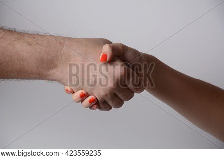Two People Shaking Hands. Man And Woman Shaking Hands Gesture