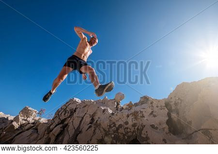 Portrait Of Active Mountain Trail Runner Dressed Bright T-shirt With Backpack And Sport Sunglasses R