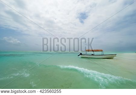 Shallow Atoll Sandbanks Turquoise Waves With Lonely Pleasure Boat Around Mnemba Island In The Indian