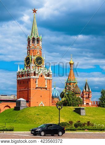 Moscow Kremlin In Summer, Russia. Vertical Scenic View Of Spasskaya Tower And St Basil's Cathedral O