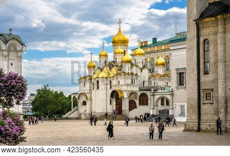 Moscow - June 2, 2021: View Of Old Annunciation Cathedral At Moscow Kremlin, Russia. People Walk On