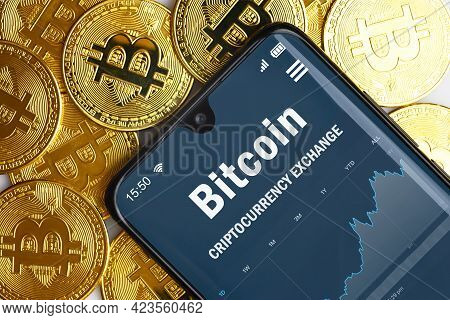 Bitcoin Digital Wallet In Smartphone And Gold Bit Coins, Crypto Currency Bitcoin Trading By Mobile P