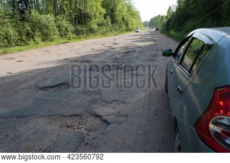 A Dusty Broken Road On The Rybinsk - Uglich Highway On A Summer Day, Russia.