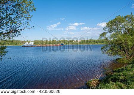 City Of Uglich, Yaroslavl Region, Russia-18.05.2021: Self-propelled Barge On The Volga River Near Th