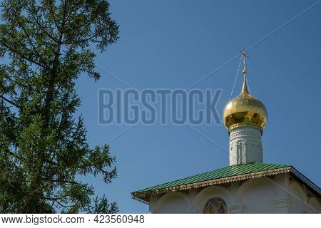 Golden Dome With A Cross On The Background Of A Blue Cloudless Sky In The Borisoglebsky Monastery, Y