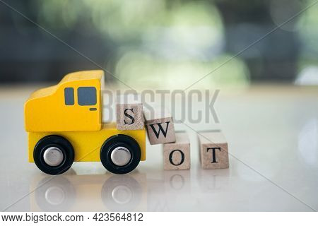 Swot Word Written On Wood Block Carry On Toy Yellow Car. Swot Strength Weakness Opportunity And Thre