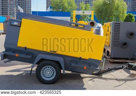 Mobile Diesel Compressor On Wheels For Supplying Pneumatic Air To Devices.