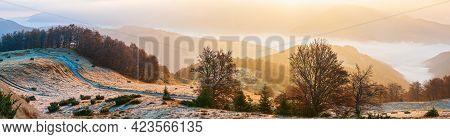 Autumn Morning Mountain Panoramic View With Sunbeams Through Haze And Low Clouds, Carpathians, Ukrai