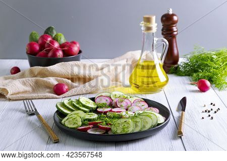 Fresh Cucumber And Radish Salad With Dill And Vegetable Oil. Vegetarian Diet. Diesta For Weight Loss