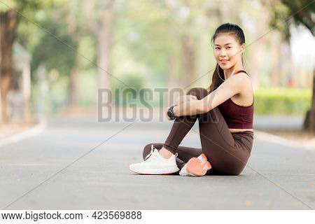 Beautiful Asian Women Exercise In The Park Every Morning, It Is A Lifestyle For Relaxation And Good