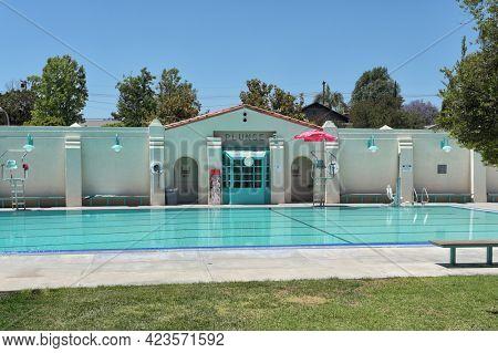 BREA, CALIFORNIA - 9 JUN 2021: The Plunge, a public swimming pool in City Hall Park.