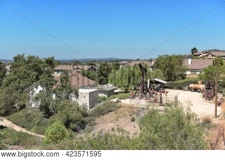 BREA, CALIFORNIA - 9 JUN 2021: Looking down on the Olinda Oil Museum and Trail seen from a vantage point on the trail.