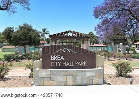 BREA, CALIFORNIA - 9 JUN 2021: Sign at City Hall Park with the Rose GArden and Plunge in the background.