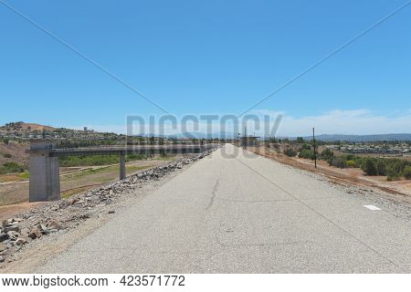 BREA, CALIFORNIA - 9 JUN 2021:  Road atop the Carbon Canyon Dam, constructed in 1959 as a response to Orange Countys growth and its need for flood control.