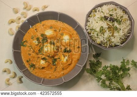 Egg Butter Masala And Green Peas Pulav. A Boiled Egg Dish With Rich Creamy Gravy Along With Green Pe