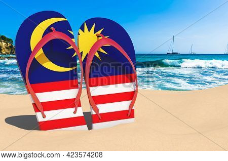 Flip Flops With Malaysian Flag On The Beach. Malaysia Resorts, Vacation, Tours, Travel Packages Conc