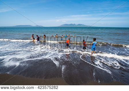 Banyuwangi, Indonesia - 13 September 2018: Chidren Swimming In Indian Ocean In Banyuwangi On Island