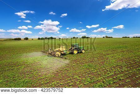 Vetrino, Bulgaria - June 6, 2021 Aerial Image Of Tractor Spraying Young Crop In Springtime In Fieldw