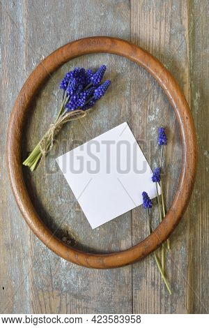 Bouquet Of Bright Spring Flowers Hyacinth Tied With Twine, And White Sheet Of Paper Inside An Oval F