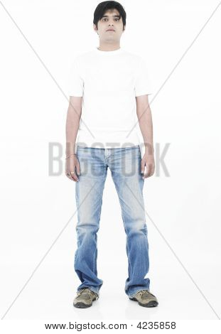 Portrait Of A Smart Looking Asian Man Standing