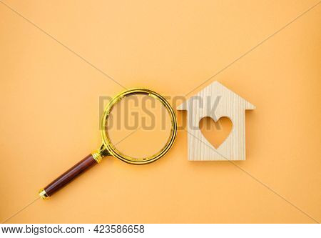 Magnifying Glass And Wooden House. House Searching Concept. Home Appraisal. Property Valuation. Choi