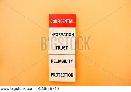 Wooden Blocks With The Words Confidential Information, Trust, Reliability, Protection. Non-public Or
