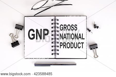 Notebook With Gnp Gross National Product On Table