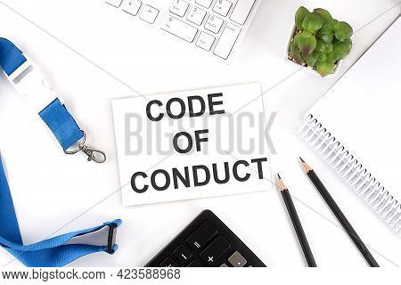 Code Of Conduct Words On Card With Keyboard And Office Tools