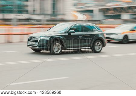 Moscow, Russia - May 2021: Front Side View Of Audi Q5 Suv In Motion. Black 4x4 Car Moving On The Str