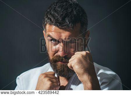 Karate Man In Kimono In Fighting Stance. Bearded Male Do Karate Training.