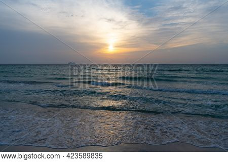 Morning Sunrise Over Sea. Ocean Sunset On Sea Water With Sunset Sky And Silhouettes Of Ship