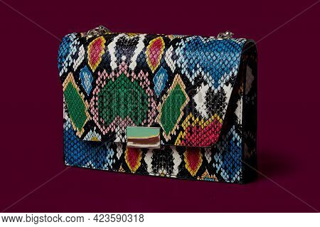 Close-up Of A Fashionable Small Handbag, A Clutch, Made Of Snakeskin.