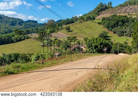 Dirty Road, Farm Field With Small House And Wood Shed In A Valley, Pinhal Alto, Nova Petropolis, Rio