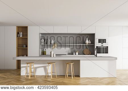 White Kitchen Room With Wooden Table And Three Bar Chairs, Front View, Parquet Floor. Cooking Set In