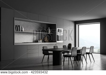 Black Kitchen Room With Long Table And Six Wooden Chairs, Side View, Concrete Floor. Cooking Set Int