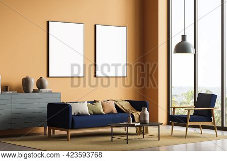 Interior Of Stylish Living Room With Orange Walls, Concrete Floor, Blue Sofa And Armchair, Cabinet A