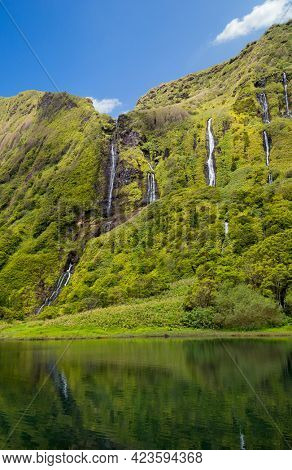 Beautiful reflection of the Poco Ribeira do Ferreiro waterfalls on Flores island in the Azores.