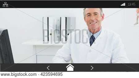 Composition of male doctor smiling on digital image interface screen. medical and healthcare services communication digital interface concept digitally generated image.