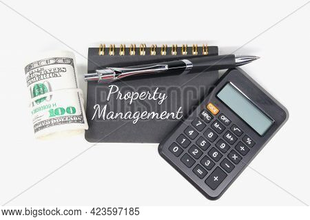 Calculator, Notebook, Pen, Roll Of Paper Money And The Word Property Management