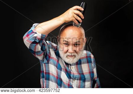Old Man With Hair Clipper Isolated On Black. Bald Man Hairclipper, Mature Baldness And Hair Loss Con