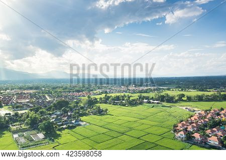 Land And Housing Estate In Aerial View.
