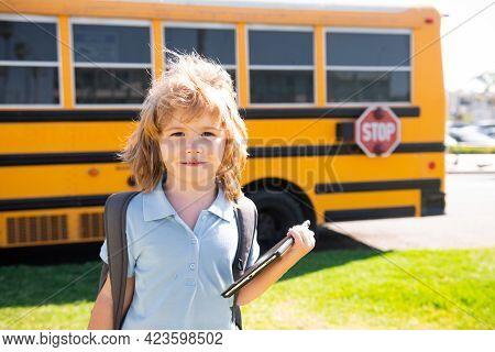 Back To School. Happy Child Near School Bus. Cute School Boy Potrait.