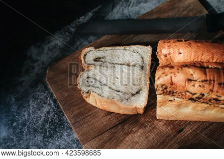 Fresh Homemade Loaf Of Bread With Truffle With A Chef Holding Gold Knife For Cut. Bakery Gold Rustic