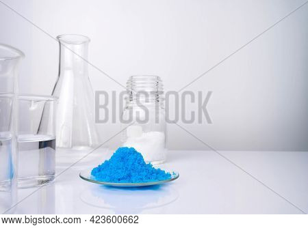 Close Up Inorganic Chemical On White Laboratory Table. Copper(ii) Sulfate, Microcrystalline Wax And